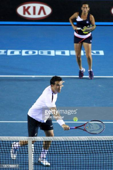 Daniele Bracciali of Italy plays a backhand in his semifinal mixed doubles match with Roberta Vinci of Italy against Leander Paes of India and Elena...