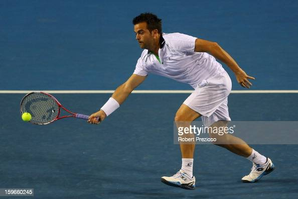 Daniele Bracciali of Italy plays a backhand with Lukas Dlouhy of Czech Republic during their third round doubles match against Alex Bolt of Australia...