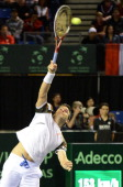 Daniele Bracciali of Italy plays against the Canadians Daniel Nestor and Vasek Pospisil at the Davis Cup World Group's doubles rubber on April 6 at...