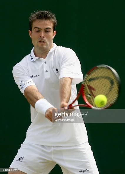 Daniele Bracciali of Italy returns a backhand to Jonas Bjorkman of Sweden during day five of the Wimbledon Lawn Tennis Championships at the All...