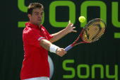 Daniele Bracciali of Italy returns to Max Mirnyi of Belarus during day three at the 2007 Sony Ericsson Open at the Tennis Center at Crandon Park on...