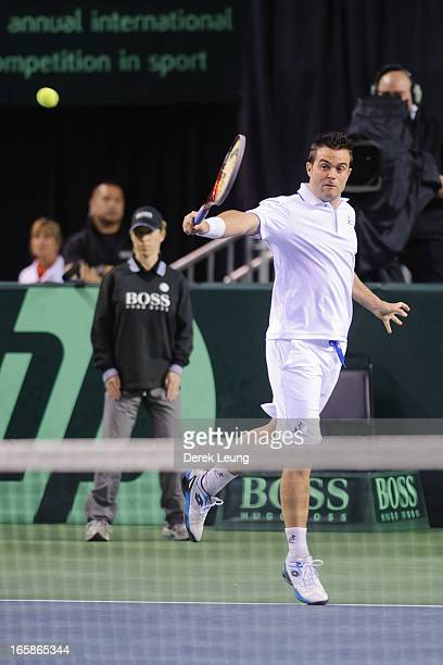 Daniele Bracciali of Italy returns to Vasek Pospisil and Daniel Nestor of Canada during their doubles match on day two of the 2013 Davis Cup...