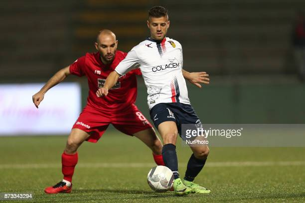 Daniele Casiraghi of AS Gubbio 1910 compete for the ball with Stefano Amadio of Teramo Calcio 1913 during the Lega Pro 17/18 group B match between...