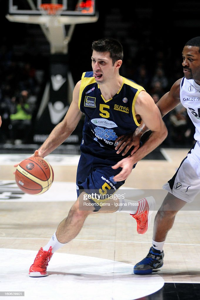 Daniele Cinciarini of Sutor competes with Ricky Minard of SAIE3 during the LegaBasket Serie A match between Virtus Bologna SAIE3 and Sutor Montegranaro at Unipol Arena on February 3, 2013 in Bologna, Italy.
