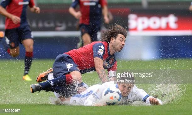 Daniele Conti of Cagliari Calcio battles for the ball with Mateo Kovacic of FC Internazionale Milano during the Serie A match between Cagliari Calcio...