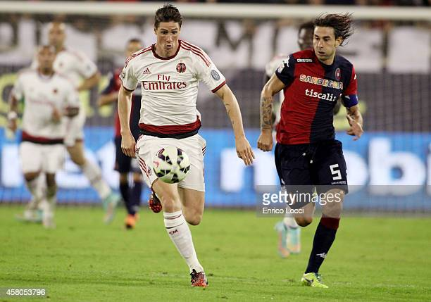 Daniele Conti of Cagliari challenges Torres Fernando of Milan during the Serie A match between Cagliari Calcio and AC Milan at Stadio Sant'Elia on...