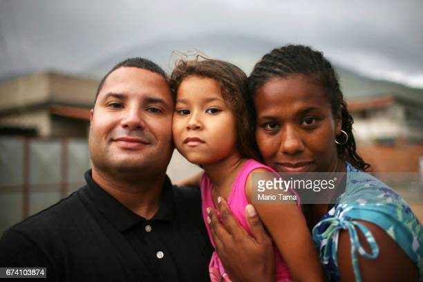 Daniele Corra de Arajo dos Praseres Jonatas Assuno dos Praseres and Sarah Ashley de Arajo dos Praseres pose outside their home on April 21 2015 in...