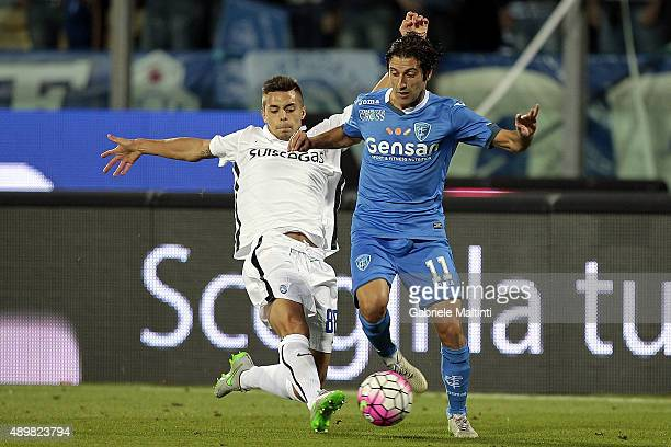 Daniele Croce of Empoli FC battles for the ball with Alberto Grassi of AC Atalanta BC during the Serie A match between Empoli FC and Atalanta BC at...