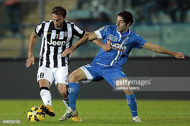 Daniele Croce of Empoli FC battles for the ball with Claudio Marchisio of Juventus FC during the Serie A match between Empoli FC and Juventus FC at...