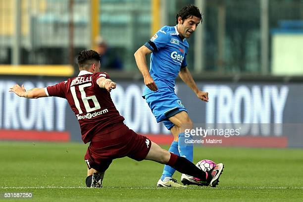 Daniele Croce of Empoli FC battles for the ball with Danele Baselli of Torino FC during the Serie A match between Empoli FC and Torino FC at Stadio...