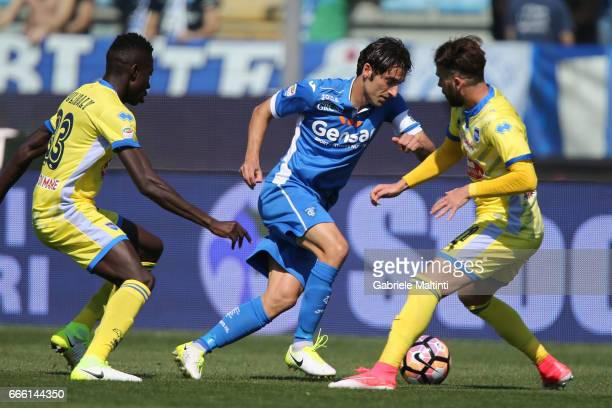 Daniele Croce of Empoli Fc battles for the ball with Mamadou Coulibaly and Cristiano Biraghi of Pescara Calcio during the Serie A match between...