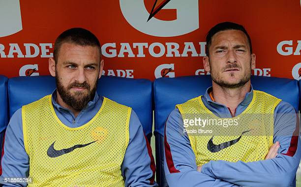 Daniele De Rossi and Francesco Totti of AS Roma look on during the Serie A match between SS Lazio and AS Roma at Stadio Olimpico on April 3 2016 in...
