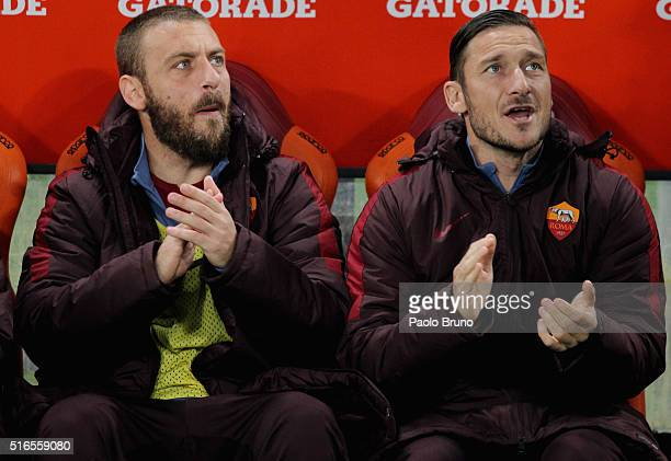 Daniele De Rossi and Francesco Totti of AS Roma react during the Serie A match between AS Roma and FC Internazionale Milano at Stadio Olimpico on...