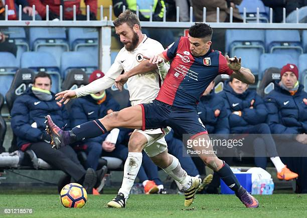 Daniele De Rossi and Giovanni Simeone during the Serie A match between Genoa CFC and AS Roma at Stadio Luigi Ferraris on January 8 2017 in Genoa Italy