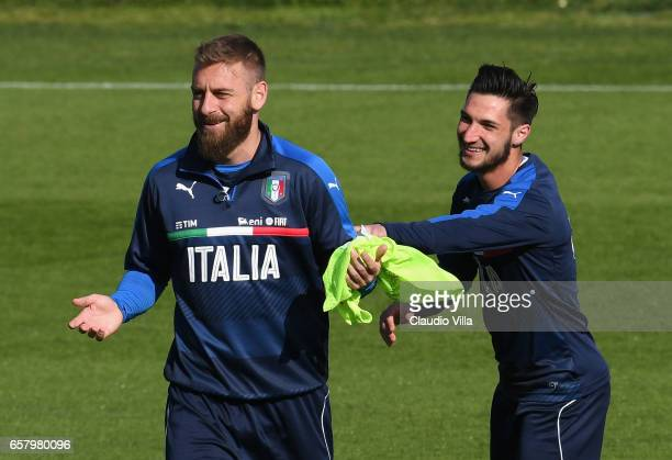 Daniele De Rossi and Matteo Politano of Italy react during the training session at the club's training ground at Coverciano on March 26 2017 in...
