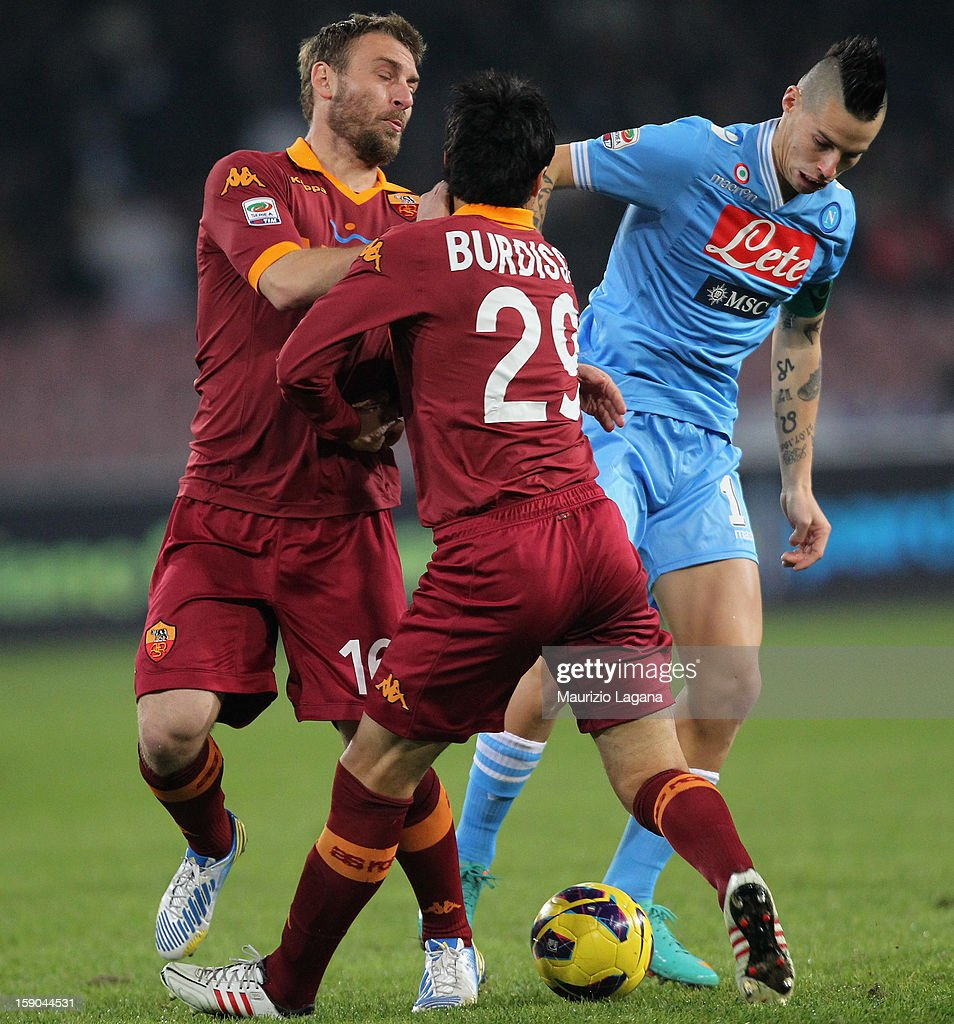 <a gi-track='captionPersonalityLinkClicked' href=/galleries/search?phrase=Daniele+De+Rossi&family=editorial&specificpeople=233652 ng-click='$event.stopPropagation()'>Daniele De Rossi</a> (L) and <a gi-track='captionPersonalityLinkClicked' href=/galleries/search?phrase=Nicolas+Burdisso&family=editorial&specificpeople=490963 ng-click='$event.stopPropagation()'>Nicolas Burdisso</a> (C) of Roma competes for the ball with Marek Hamsik of Napoli during the Serie A match between SSC Napoli and AS Roma at Stadio San Paolo on January 6, 2013 in Naples, Italy.