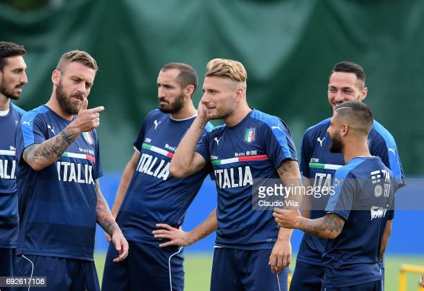 Daniele De Rossi Ciro Immobile Lorenzo Insigne and Danilo D'Ambrosio chat during the training session at Coverciano on June 05 2017 in Florence Italy