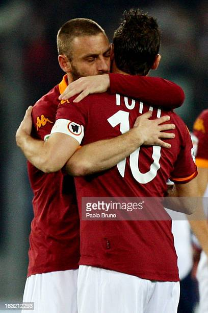 Daniele De Rossi embraces his teammate Francesco Totti of AS Roma during the Serie A match between AS Roma and Genoa CFC at Stadio Olimpico on March...