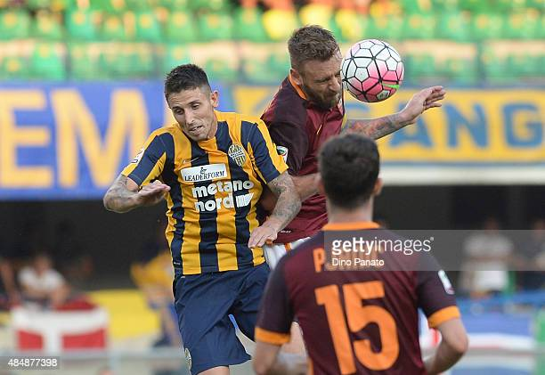 Daniele De Rossi of AS battles for an aerial ball during the Serie A match between Hellas Verona FC and AS Roma at Stadio Marc'Antonio Bentegodi on...