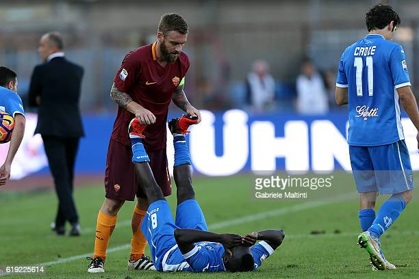 Daniele De Rossi of AS Roma and Assane Diousse' of Empoli FC during the Serie A match between Empoli FC and AS Roma at Stadio Carlo Castellani on...
