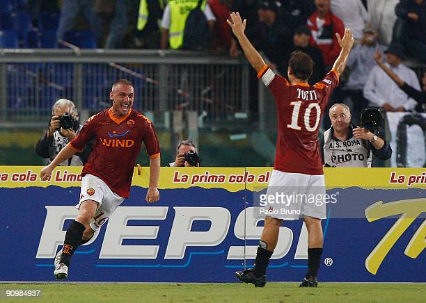Daniele De Rossi of AS Roma celebrates after scoring the 30 goal with fellow goalscorer Francesco Totti during the Serie A match between AS Roma and...