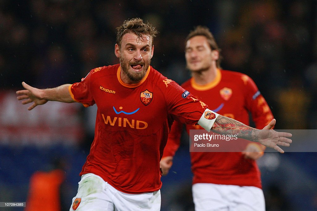 <a gi-track='captionPersonalityLinkClicked' href=/galleries/search?phrase=Daniele+De+Rossi&family=editorial&specificpeople=233652 ng-click='$event.stopPropagation()'>Daniele De Rossi</a> of AS Roma celebrates after scoring the second goal during the UEFA Champions League Group E match between AS Roma and FC Bayern Muenchen at Stadio Olimpico on November 23, 2010 in Rome, Italy.