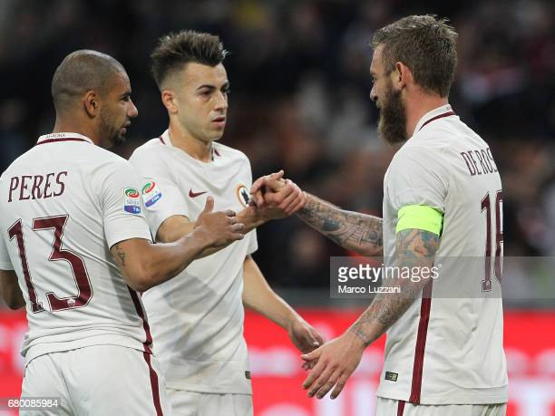 Daniele De Rossi of AS Roma celebrates his goal with his teammates Stephan El Shaarawy and Bruno Peres during the Serie A match between AC Milan and...