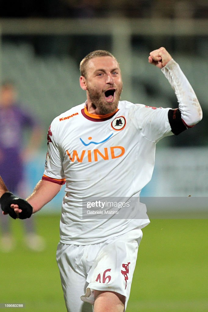 <a gi-track='captionPersonalityLinkClicked' href=/galleries/search?phrase=Daniele+De+Rossi&family=editorial&specificpeople=233652 ng-click='$event.stopPropagation()'>Daniele De Rossi</a> of AS Roma celebrates the victory after the TIM cup match between ACF Fiorentina and AS Roma at Artemio Franchi on January 16, 2013 in Florence, Italy.