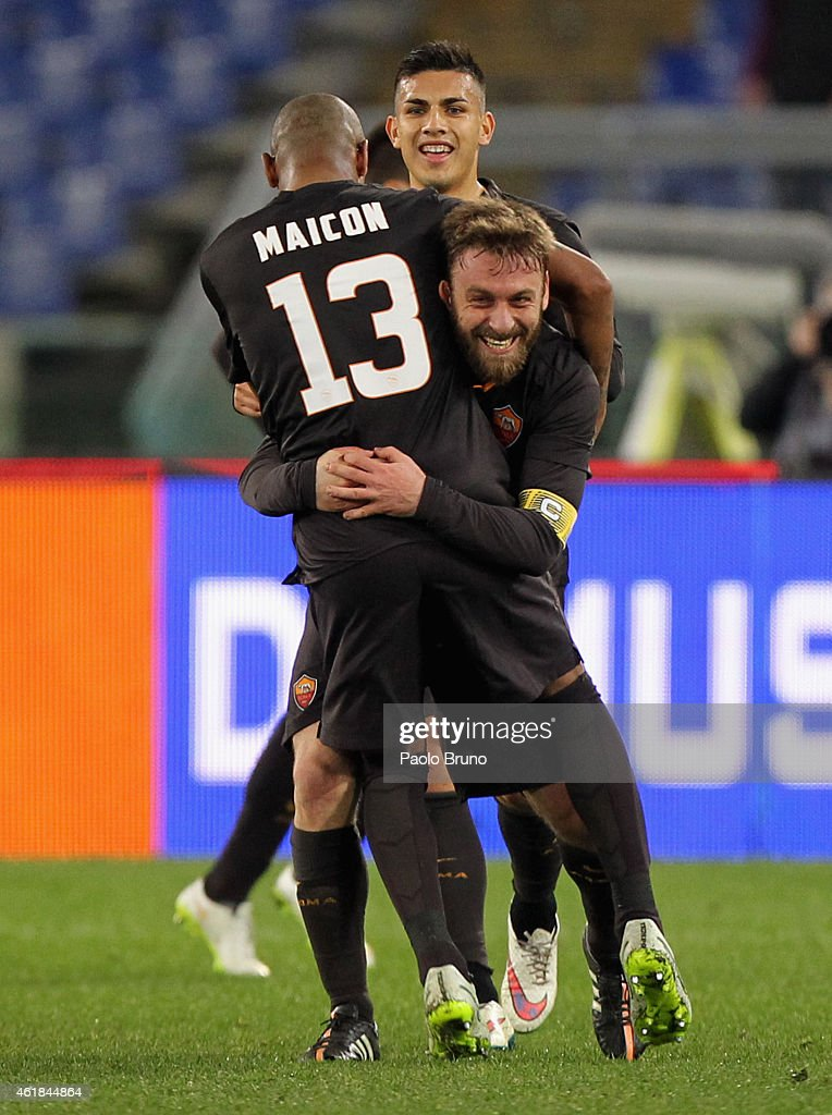 <a gi-track='captionPersonalityLinkClicked' href=/galleries/search?phrase=Daniele+De+Rossi&family=editorial&specificpeople=233652 ng-click='$event.stopPropagation()'>Daniele De Rossi</a> of AS Roma celebrates with his team-mate <a gi-track='captionPersonalityLinkClicked' href=/galleries/search?phrase=Maicon+-+Brazil+National+Soccer+Team+and+A.S.+Roma&family=editorial&specificpeople=2639404 ng-click='$event.stopPropagation()'>Maicon</a> after scoring their second goal from penalty spot during the TIM Cup match between AS Roma and Empoli FC at Olimpico Stadium on January 20, 2015 in Rome, Italy.