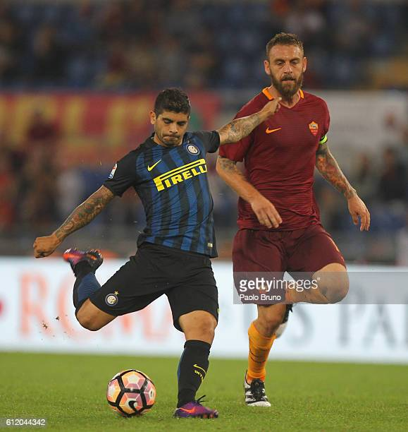 Daniele De Rossi of AS Roma competes for the ball with Eder Banega of FC Internazionale during the Serie A match between AS Roma and FC...