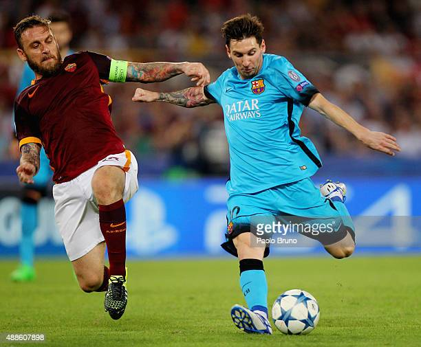 Daniele De Rossi of AS Roma competes for the ball with Lionel Messi of FC Barcelona during the UEFA Champions League Group E match between AS Roma...