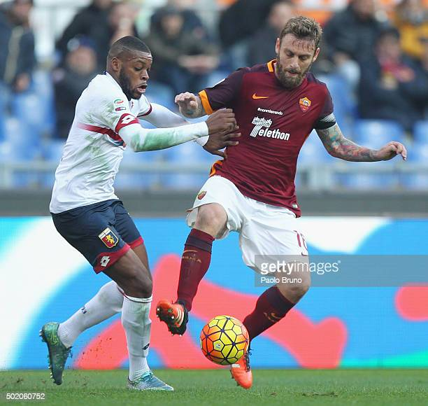 Daniele De Rossi of AS Roma competes for the ball with Olivier Ntcham of Genoa CFC during the Serie A match between AS Roma and Genoa CFC at Stadio...