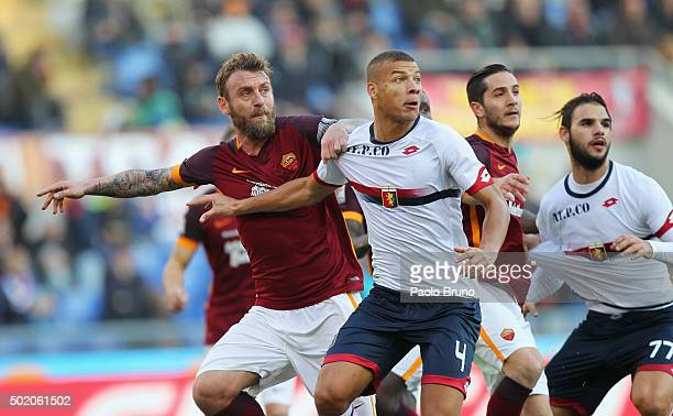 Daniele De Rossi of AS Roma competes for the ball with Sebastian De Maio of Genoa CFC during the Serie A match between AS Roma and Genoa CFC at...