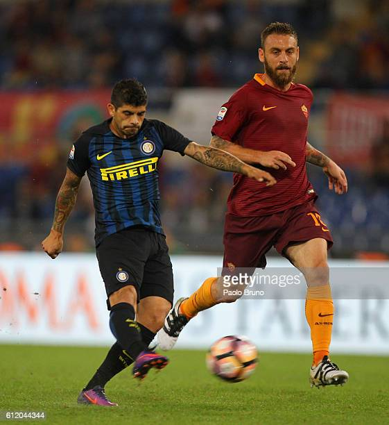 Daniele De Rossi of AS Roma in action as Eder Banega of FC Internazionale kicks the ball during the Serie A match between AS Roma and FC...