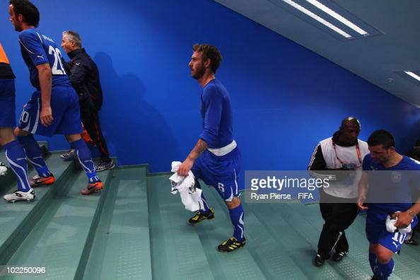Daniele De Rossi of Italy and his team mates show their dejection as they walk up the stairs to the dressing room after the 2010 FIFA World Cup South...