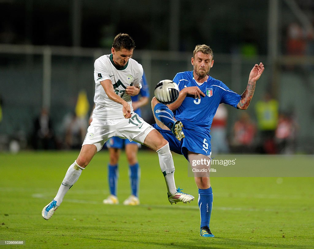 Daniele De Rossi of Italy and Kirm Andraz of Slovenia battle for the ball during the EURO 2012 Qualifier match between Italy and Slovenia at Stadio Artemio Franchi on September 6, 2011 in Florence, Italy.
