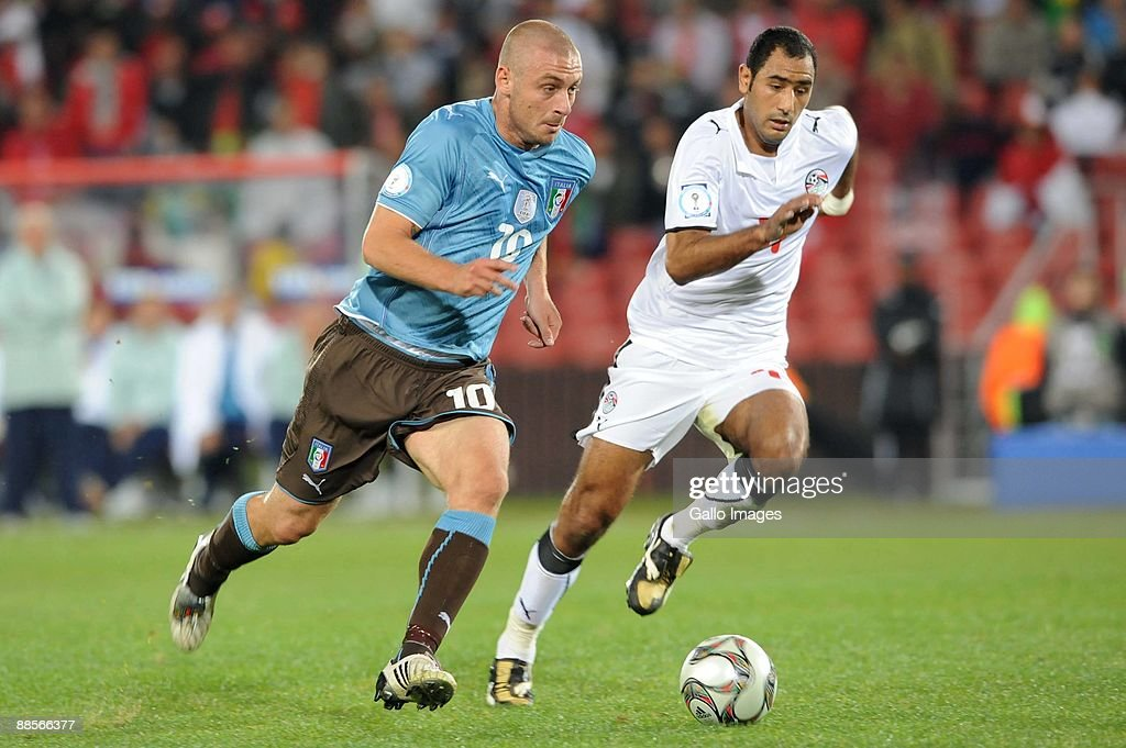 Daniele De Rossi of Italy and Mohamed Shawky of Egypt battle during the 2009 Confederations Cup match between Egypt and Italy at CocaCola Stadium on...