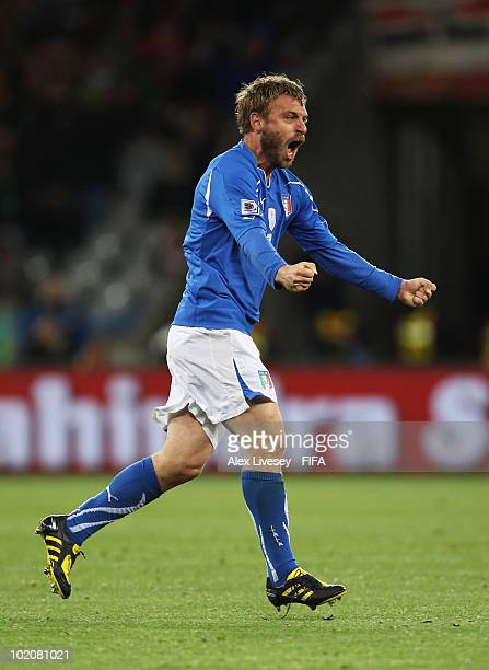 Daniele De Rossi of Italy celebrates scoring his team's first goal during the 2010 FIFA World Cup South Africa Group F match between Italy and...