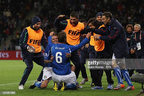 Daniele De Rossi of Italy celebrates scoring his team's first goal with team mates during the 2010 FIFA World Cup South Africa Group F match between...