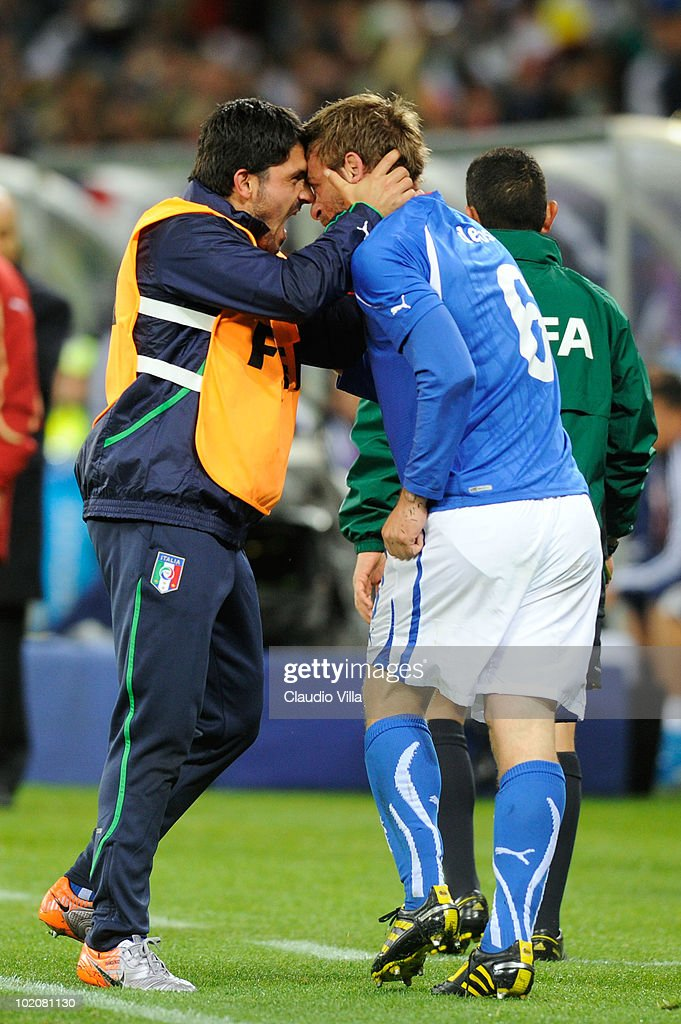 <a gi-track='captionPersonalityLinkClicked' href=/galleries/search?phrase=Daniele+De+Rossi&family=editorial&specificpeople=233652 ng-click='$event.stopPropagation()'>Daniele De Rossi</a> of Italy (R) celebrates scoring his team's first goal with team mate <a gi-track='captionPersonalityLinkClicked' href=/galleries/search?phrase=Gennaro+Gattuso&family=editorial&specificpeople=210827 ng-click='$event.stopPropagation()'>Gennaro Gattuso</a> during the 2010 FIFA World Cup South Africa Group F match between Italy and Paraguay at Green Point Stadium on June 14, 2010 in Cape Town, South Africa.
