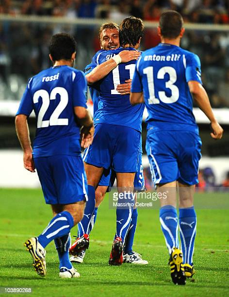 Daniele De Rossi of Italy celebrates with team mates after scoring his team's second goal during the Euro 2012 qualifying match between Italy and...