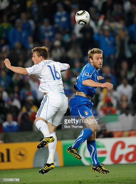 Daniele De Rossi of Italy heads the ball with Jan Durica of Slovakia during the 2010 FIFA World Cup South Africa Group F match between Slovakia and...