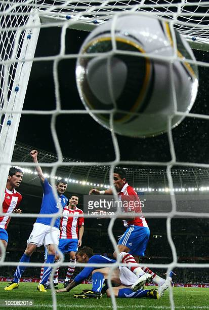 Daniele De Rossi of Italy scores his team's first goal during the 2010 FIFA World Cup South Africa Group F match between Italy and Paraguay at Green...