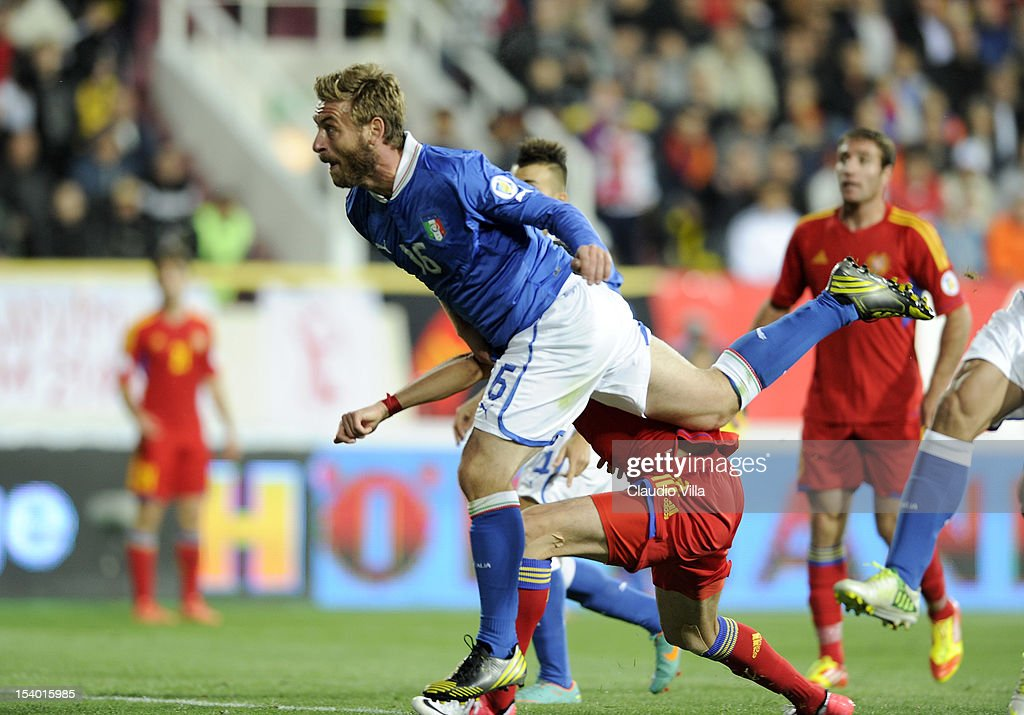 <a gi-track='captionPersonalityLinkClicked' href=/galleries/search?phrase=Daniele+De+Rossi&family=editorial&specificpeople=233652 ng-click='$event.stopPropagation()'>Daniele De Rossi</a> of Italy #16 scores the second goal during the FIFA 2014 World Cup Qualifier group B match between Armenia and Italy at Hrazdan Stadium on October 12, 2012 in Yerevan, Armenia.