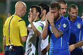 Daniele De Rossi of Italy shows his dejection after referee Sergei Karasev showed him the red card during the UEFA EURO 2016 Qualifier match between...