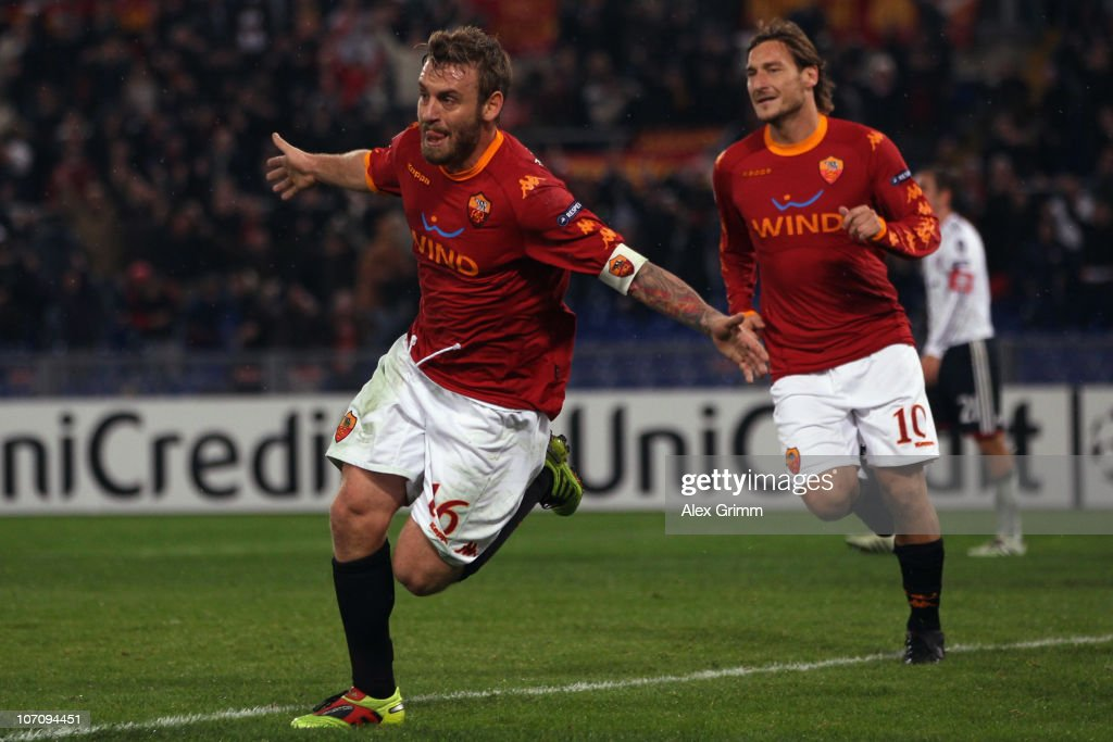 Daniele de Rossi (L) of Roma celebrates his team's second goal with team mate <a gi-track='captionPersonalityLinkClicked' href=/galleries/search?phrase=Francesco+Totti&family=editorial&specificpeople=208985 ng-click='$event.stopPropagation()'>Francesco Totti</a> during the UEFA Champions League group E match between AS Roma and FC Bayern Muenchen at Stadio Olimpico on November 23, 2010 in Rome, Italy.