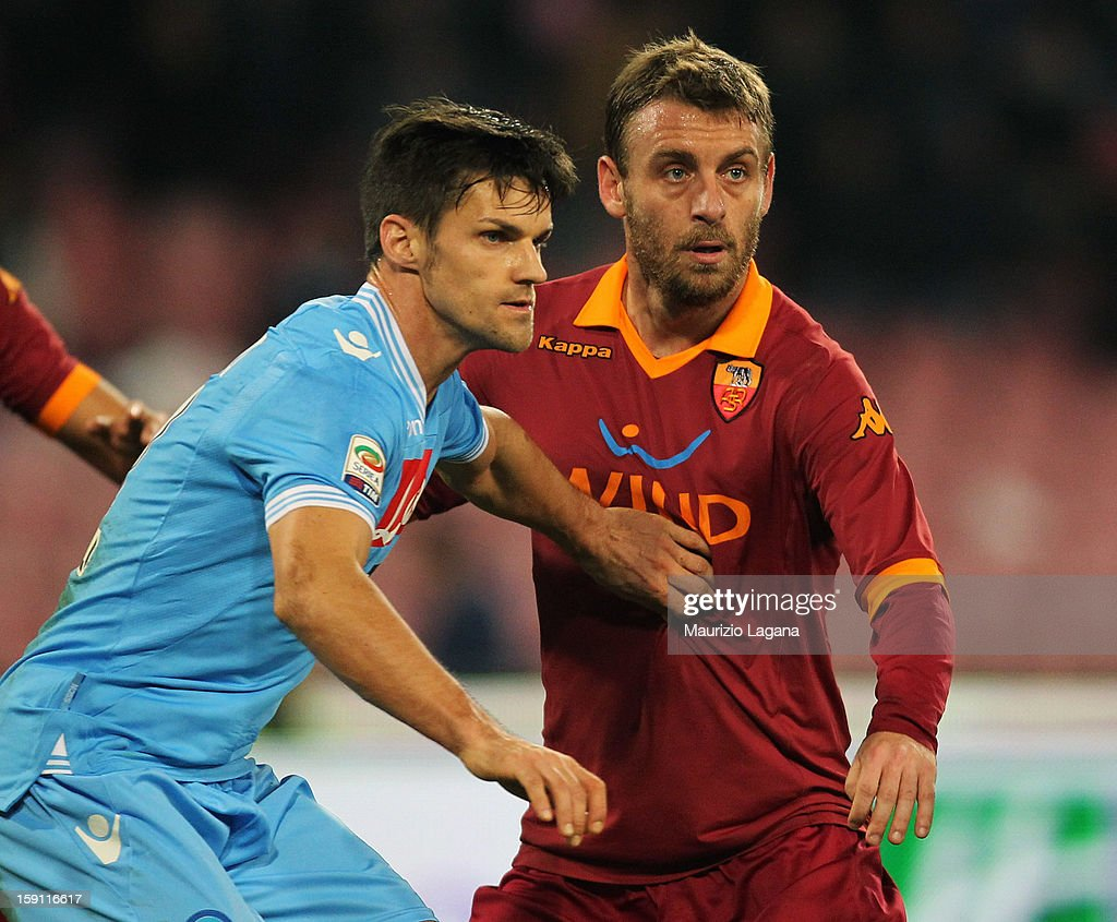 Daniele De Rossi (R) of Roma competes for the ball with Christian Maggio of Napoli during the Serie A match between SSC Napoli and AS Roma at Stadio San Paolo on January 6, 2013 in Naples, Italy.