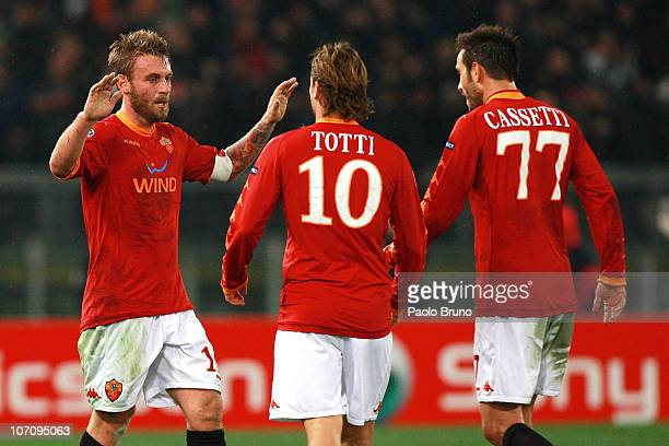 Daniele De Rossi with his teammates Francesco Totti and Marco Cassetti of AS Roma celebrates after scoring the second goal during the UEFA Champions...