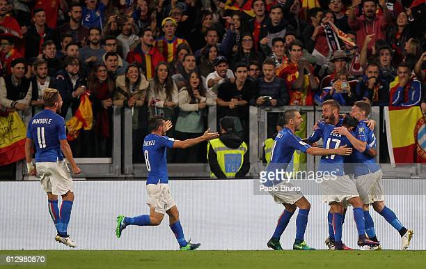 Daniele De Rossi with his teammates of Italy celebrates after scoring the team's first goal from penalty spot during the FIFA 2018 World Cup...
