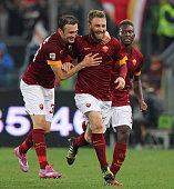 Daniele De Rossi with his teammates Vasilis Torosidis and Mapou YangaMbiwa of AS Roma celebrates after scoring the team's second goal during the...